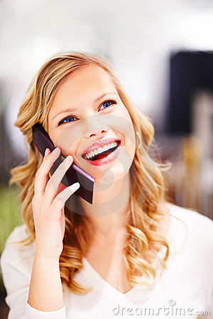 Young woman speaking on a mobile phone