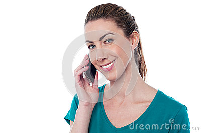 Young woman speaking over cellphone