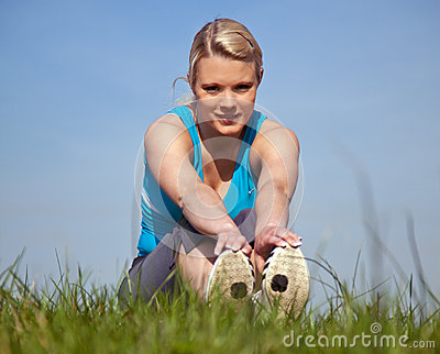 Young woman in sports wear outside