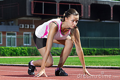 Young woman in sprinting position
