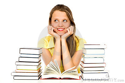 Young woman with stacks of books