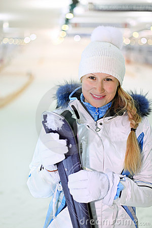 Young woman stand with skis
