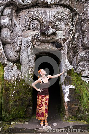 Young woman standing in the demon mouth at Goa