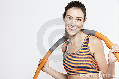 Young woman standing with a hula hoop, smiling Stock Photo