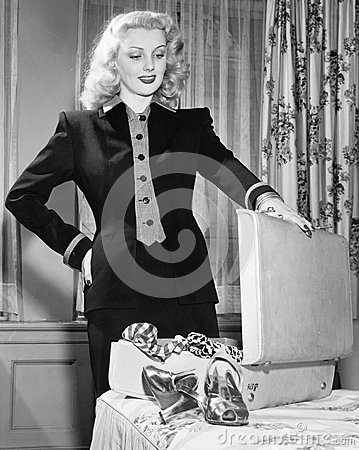 Free Young Woman Standing Next To Her Bed, Holding Onto The Suitcase, Thinking Of What To Pack Royalty Free Stock Photo - 52026475