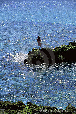 Free Young Woman Standing Rocks, Looking Out To Sea Stock Photography - 6078502