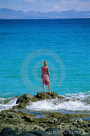 Free Young Woman Standing Rocks, Looking Out To Sea Royalty Free Stock Image - 6079036