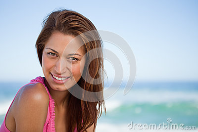 Young woman staring at the camera while sunbathing