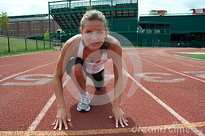 Young Woman at Starting Line on Running Track