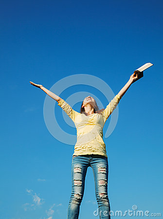 Young woman staying with raised hands