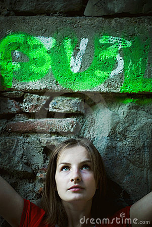 Young woman by stone wall