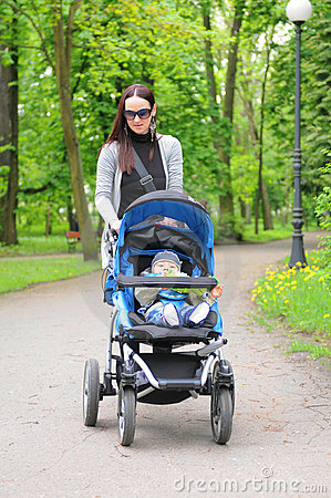 Young Woman With A Stroller Royalty Free Stock Image - Image: 21122686