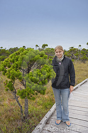 Young Woman with stunted Shore Pine in a Bog