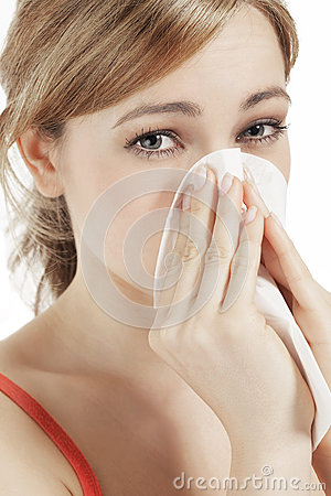 Young woman suffering on hay fever