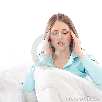 A young woman suffering from head pain