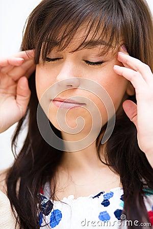 Woman is suffering headache