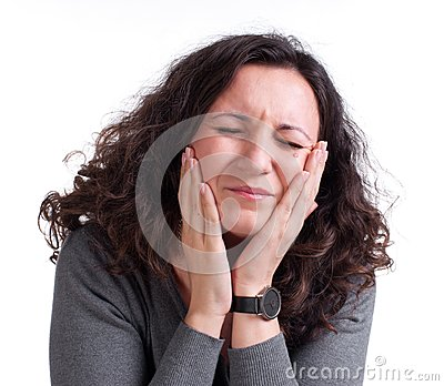 Young woman suffering from a toothache