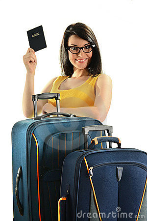 Young woman with suitcases isolated on white