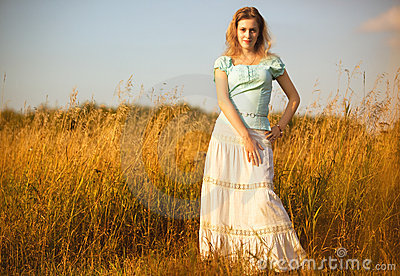 Young woman on a summer field