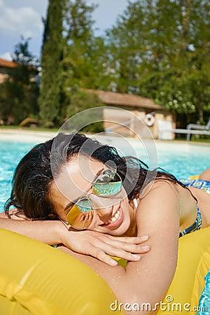 Free Young Woman Sun Bathing In Spa Resort Swiming Pool Stock Photography - 95397492