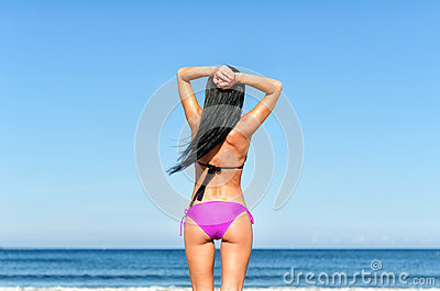 Young woman sunbathes
