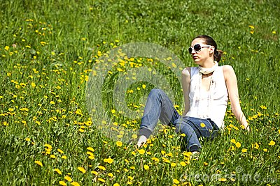 Young woman with sunglasses in nature