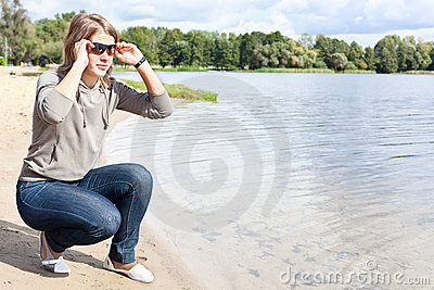 Young woman with sunglasses on shore