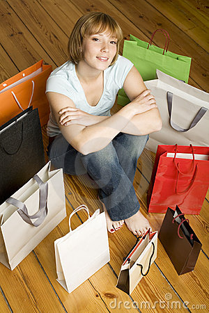 Young woman surrounded by bags