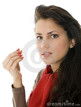 Young woman swallowing drug