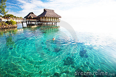 Young woman swimming in a coral lagoon