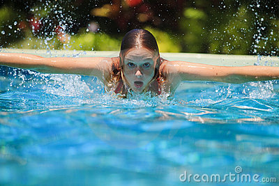 Young woman swimming in a pool