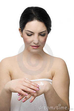 Young woman take care of her hands with cream