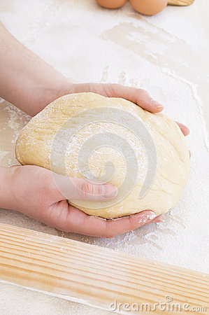 Young woman taking the dough