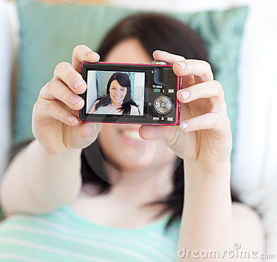 Young woman taking a photo of herself