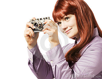 Young woman taking picture with a camera