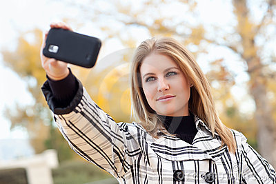 Young Woman Taking Picture with Camera Phone