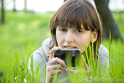 Young woman taking picture with digital camera