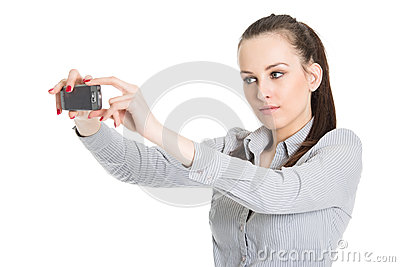 Young woman taking picture with mobile phone