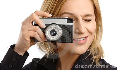 Young woman taking a shot with photo camera