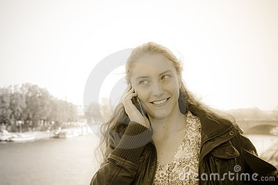 Young woman talk on a cellular telephone