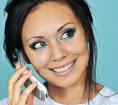 Young woman talking on her cell phone