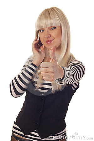 Young woman talking by mobile showing hand ok sign