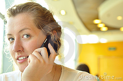 Young woman is talking phone