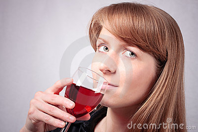 Young woman tasting a glass of wine. #3