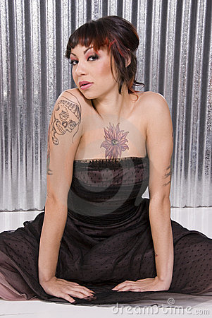 Young woman with tattoos