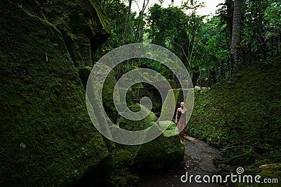 Young woman among temple ruins