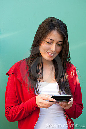Young woman texting messages on mobile phone
