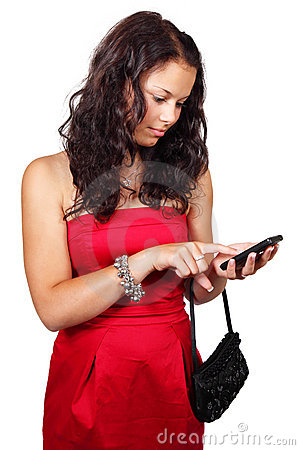 Young woman texting on touch screen phone