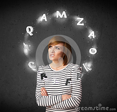 Young woman thinking with letter circulation around her head Stock Photo