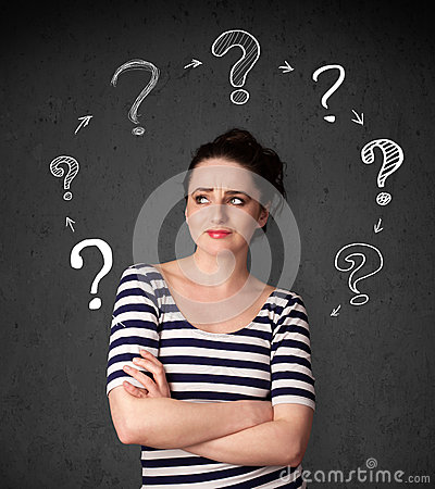 Young woman thinking with question mark circulation around her h Stock Photo